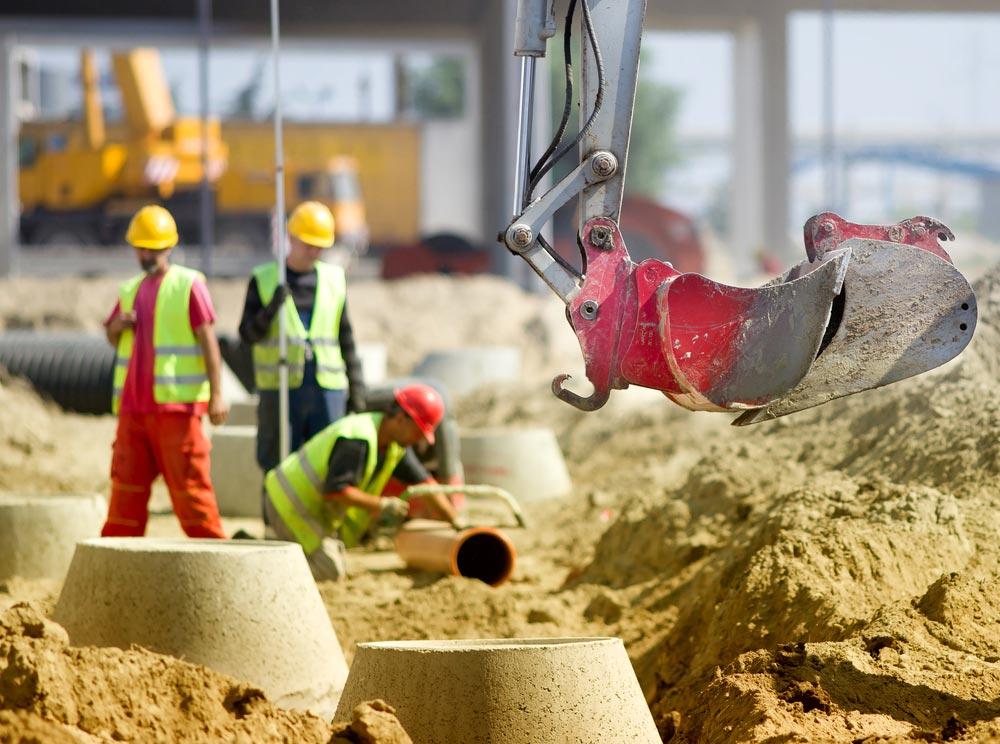 Erschließung von Eigenheimgebieten Kanalreparaturen Sanierung Schachtdeckelsanierung